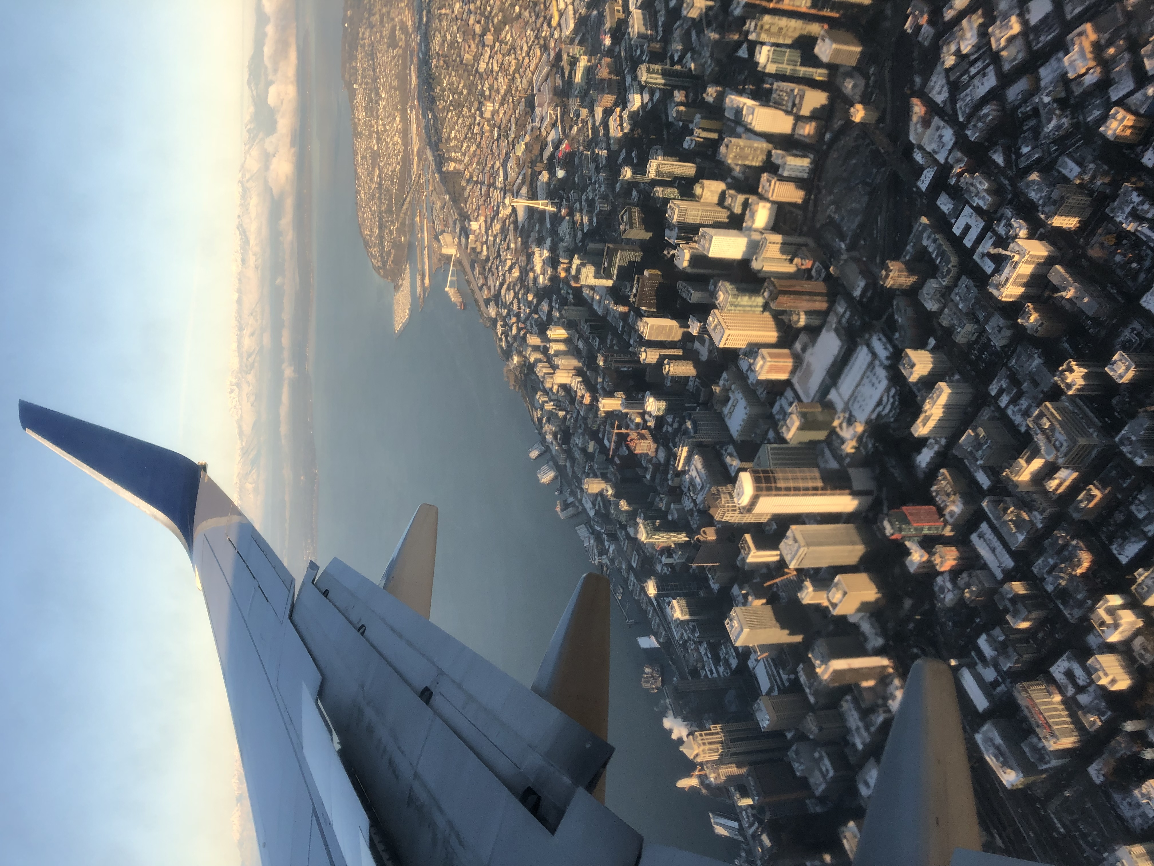 Airplane window view of downtown Seattle.