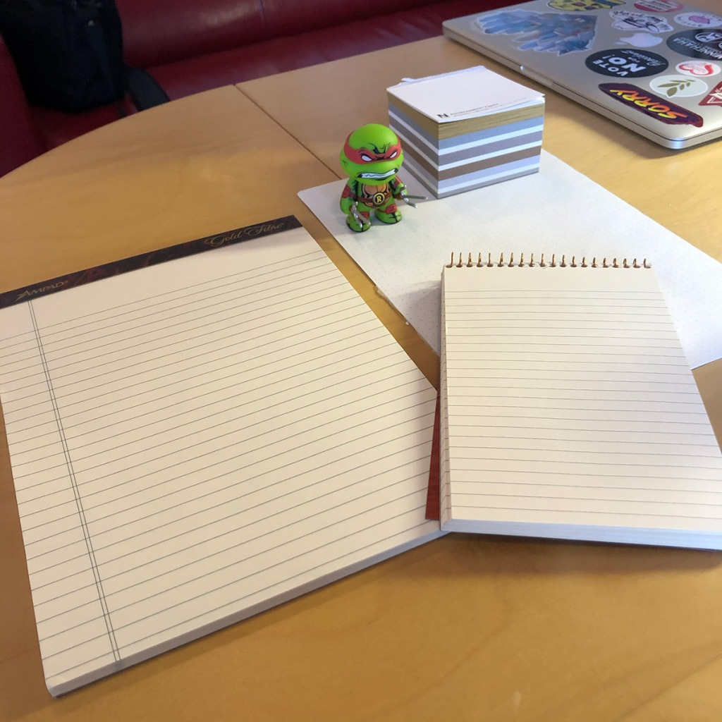 Author's photograph of several pads of paper on a desk referenced in the article.